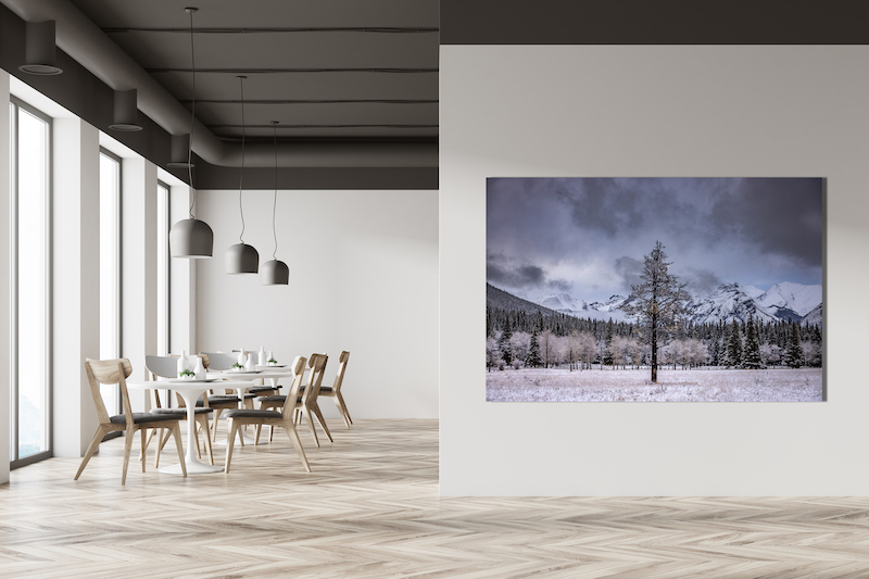 White cafe interior with a wooden floor, tall windows and gray and wooden chairs near round tables. A blank wall fragment. 3d rendering mock up